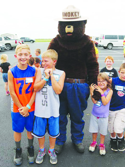 "One of many visitors to the Junior Deputy Boot Camp in Peebles was this big ""bear"", who always brings a message about how the children can prevent fires."