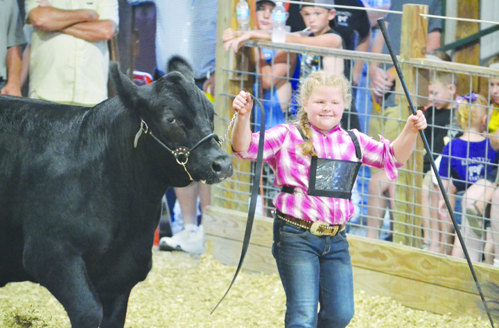 A week at the fair is all about joy and smiles and no one personified that more than 9-year old Isabella Crum from Peebles as she showed her Angus crossbred steer in her first year as an active 4-H member.