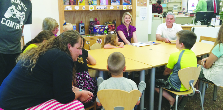 """U.S. Congressman Brad Wenstrup, far right, visited the North Adams Library on June 28 and participated in Story Time with the kids, reading """"Fourth of July Fireworks."""""""