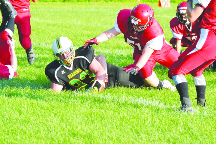 West Union's Jordan Hendricks barely makes it across the goal line on a 10-yard touchdown run that opened the scoring in the Dragons' 34-0 win over Eastern Brown on Friday night at Freedom Field.