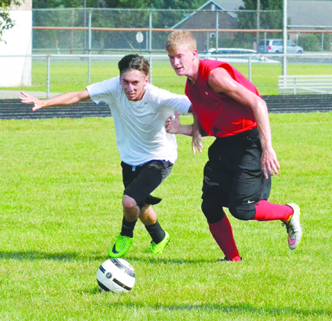 As the lone senior on the Peebles boys soccer roster, Logan Gordley, right, will be counted on by Coach Brian Seaman to anchor the Indians' defense.