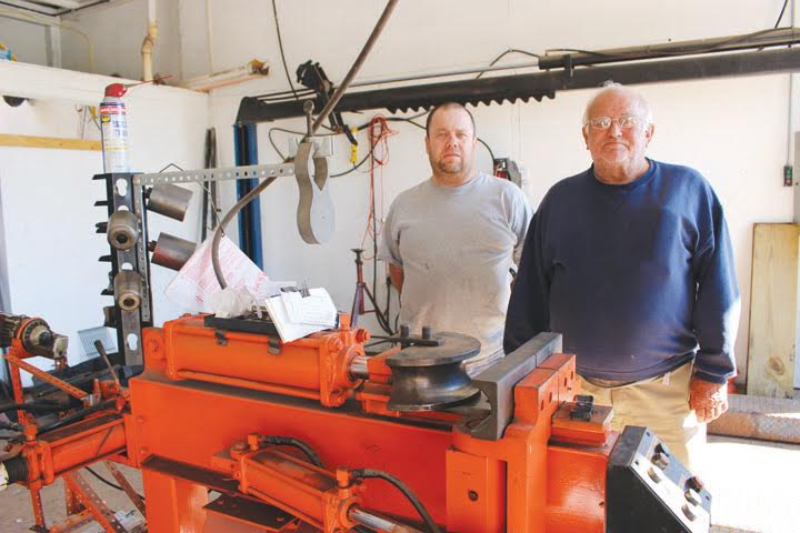 John Rideout, right, and his son Brian, will be celebrating their 40th year of being in the muffler business this month.
